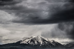 Stormy Mount Sopris Colorado. Dangerous stormy weather for snow sking is rolling in over Mt Sopris in Colorado. This famous mountain is located near Aspen Royalty Free Stock Photos