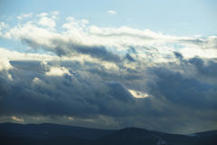 Stormy mountain cloudscape, rainy clouds nature Stock Images