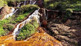 Stormy mountain river forming a cascade of waterfalls - Datanla waterfalls. Vietnam. drone view.  stock footage