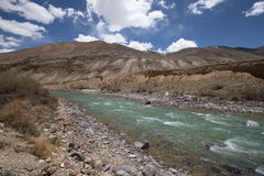 Stormy mountain river in valley in the foothills of the Fann mou Royalty Free Stock Photography