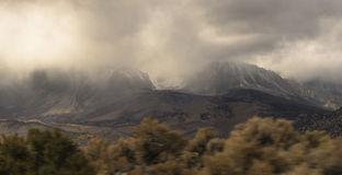 Stormy Mountains. Looking up at the stormy Sierra Nevada Mountain Range in California Stock Image