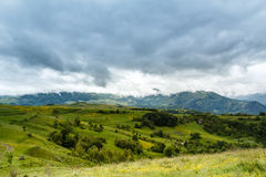 Stormy Mountains. View from the Bedeleu peak, a part of the Trascau Mountains, in a rainy day with dramatic clouds Royalty Free Stock Image