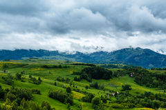 Stormy Mountains. View from the Bedeleu peak, a part of the Trascau Mountains, in a rainy day with dramatic clouds Royalty Free Stock Photography