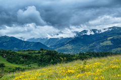 Stormy Mountains. View from the Bedeleu peak, a part of the Trascau Mountains, in a rainy day with dramatic clouds. The village from the valley is Salciua Stock Photography