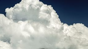 Stormy movement of three-dimensional white clouds, like a background on a blue sky stock footage