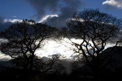 Stormy night sky. A dramatic night sky seen here in the lake district in Cumbria in the UK Stock Image
