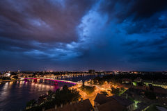 Stormy night. With thunderstorms in the city on the river stock image