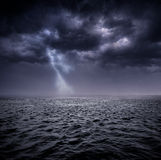 Stormy ocean. Dark stormy clouds over the ocean Royalty Free Stock Image