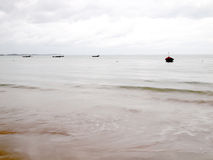 A stormy ocean beach with waves Stock Photos