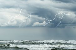 Stormy ocean. Ocean with big waves and lightning Stock Photos