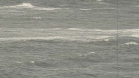 Stormy ocean in black and white stock footage