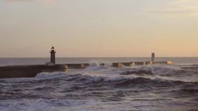 Stormy ocean at Breakwater pier with lighthouse. stock video