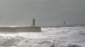 Stormy ocean at Breakwater pier with lighthouse stock footage