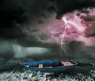 Stormy ocean. Old boat in the stormy ocean Stock Image