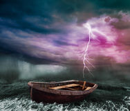 A stormy ocean. Old boat in the stormy ocean Royalty Free Stock Image