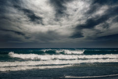 Stormy ocean with rainy clouds Stock Photos