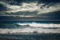 Stormy ocean with rainy clouds Royalty Free Stock Image