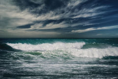 Stormy ocean with rainy clouds Stock Photo