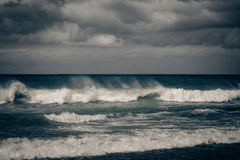 Stormy ocean with rainy clouds Royalty Free Stock Photo
