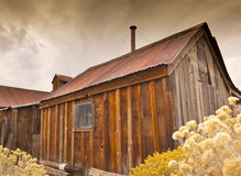Stormy old Wooden Shack. Old wooden shack on ranch.  Ghost town building in Nevada under gloomy skies Stock Image
