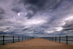 Stormy pier Royalty Free Stock Image