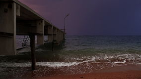 Stormy pier. Marine dock and upcoming storm stock footage