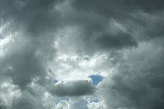 Stormy rain clouds. Ominous dark clouds form over a bright sky Royalty Free Stock Photo