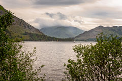 Stormy rain clouds over lake in Lake District. Stock Images