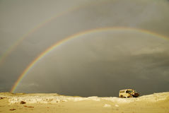 Stormy Rainbow Over Offroad Car Royalty Free Stock Photography