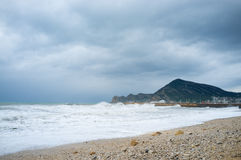 Stormy resort beach Royalty Free Stock Image