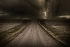 Stormy Road. Stormy Back Country Road. Heavy Storm and Lightning Bolt in a Distans. Severe Weather Imagery Collection royalty free stock photos