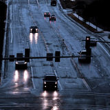 Stormy Road Driving in Rain. Cars with headlights shinning on stormy wet road driving in rain Royalty Free Stock Photography