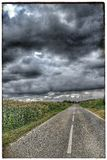 Stormy Road. Road, storm ,clouds , sky Royalty Free Stock Photography