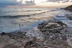Stormy rocky beach sunset on the coast of Adriatic Sea Stock Photo