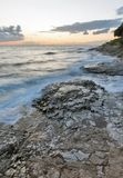 Stormy rocky beach sunset on the coast of Adriatic Sea Royalty Free Stock Photography