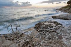 Stormy rocky beach sunset on the coast of Adriatic Sea Royalty Free Stock Photos