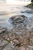 Stormy rocky beach sunset on the coast of Adriatic Sea Royalty Free Stock Image