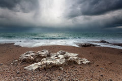 Stormy rocky coast in ocean Stock Photography