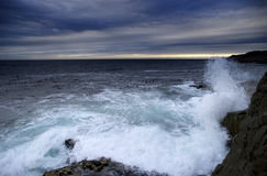 Stormy sea. Evening light over a dark and stormy sea Stock Photo