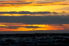 Stormy sea against the background of a color sunset Royalty Free Stock Photo