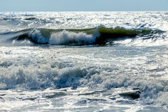 Stormy sea beach. Stormy baltic sea beach with waves under sunlight stock photo