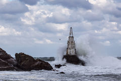 Stormy sea with big waves crashing into lighthouse Royalty Free Stock Image