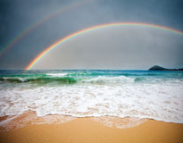 Stormy sea and cloudy sky with rainbow Royalty Free Stock Photo