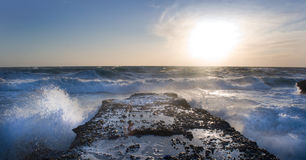Stormy sea crashes in the rocks Stock Photography