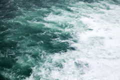 Stormy sea, deep blue water with foam. And waves, natural background photo Royalty Free Stock Image