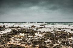Stormy sea with foamy waves and gray sky on Lanzarote. Coastline landscape, Spain Royalty Free Stock Photo