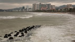 Stormy Sea Nha Trang Vietnam HD Time Lapse. Time lapse hd movie in Nha Trang Vietnam and the south China sea in stormy weather with large waves hitting the stock footage