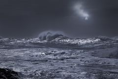 Stormy sea in an overcast full moon night stock image