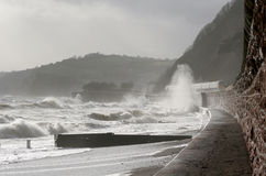 Stormy Sea's. Storm blown waves thunder against the sea wall in Torquay Royalty Free Stock Image