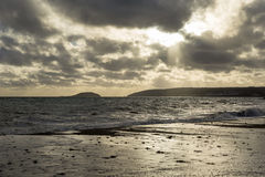 Stormy sea at seaton with looe island background Stock Image